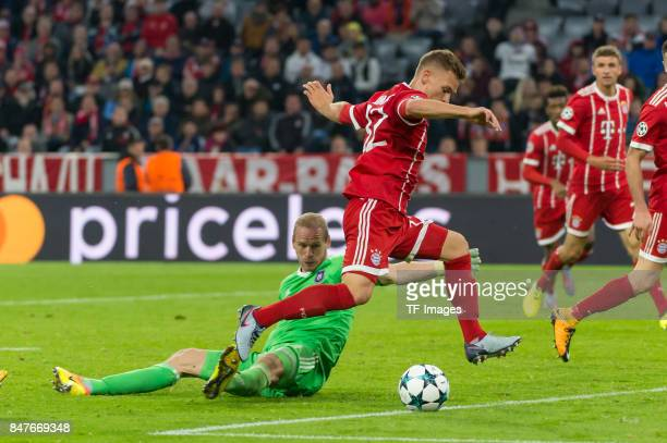 Joshua Kimmich of Bayern Muenchen and Matz Sels of RSC Anderlecht battle for the ball during the UEFA Champions League group B match between Bayern...
