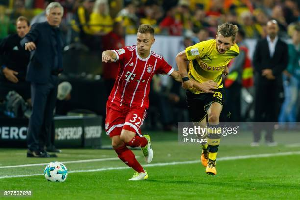 Joshua Kimmich of Bayern Muenchen and Maximilian Philipp of Dortmund battle for the ball during the DFL Supercup 2017 match between Borussia Dortmund...