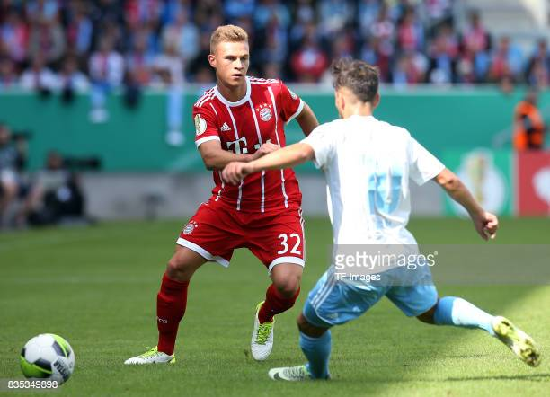 Joshua Kimmich of Bayern Muenchen and Okan Aydin of Chemnitz battle for the ball during the DFB Cup first round match between Chemnitzer FC and FC...