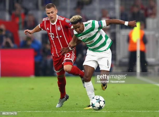 Joshua Kimmich of Bayern Muenchen and Scott Sinclair of Celtic battle for possession during the UEFA Champions League group B match between Bayern...