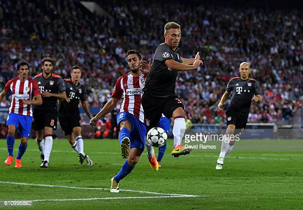 Joshua Kimmich of Bayern Muenchen battles for the ball with Koke of Atletico Madrid during the UEFA Champions League group D match between Club...