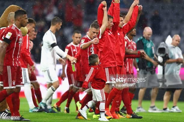 Joshua Kimmich of Bayern Muenchen celebrates after winning the Bundesliga match between FC Bayern Muenchen and Bayer 04 Leverkusen at Allianz Arena...