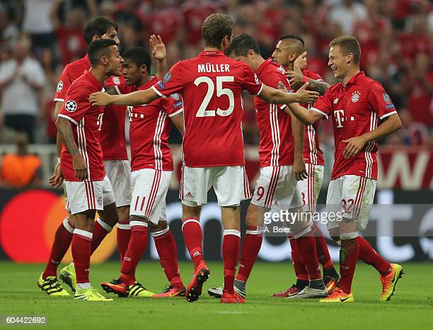 Joshua Kimmich of Bayern Muenchen celebrates his first goal with teammates during the UEFA Champions League match between FC Bayern Muenchen and FC...