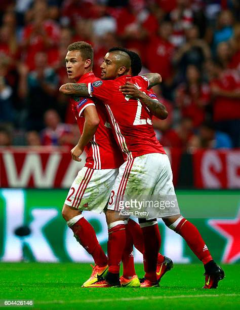 Joshua Kimmich of Bayern Muenchen celebrates scoring his sides third goal with Arturo Vidal during the UEFA Champions League Group D match between FC...