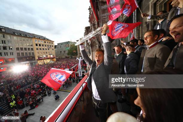Joshua Kimmich of Bayern Muenchen celebrates winning the 67th German Championship title on the town hall balcony at Marienplatz on May 20 2017 in...
