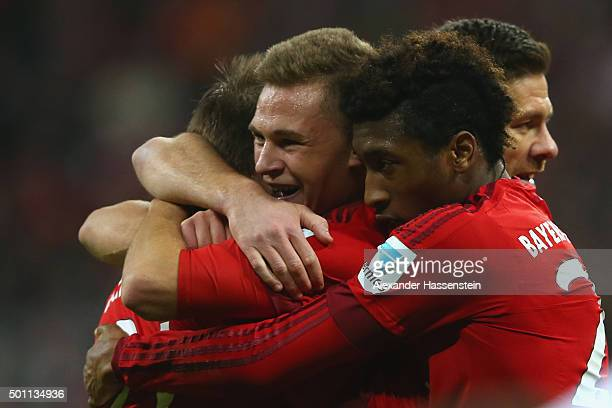 Joshua Kimmich of Bayern Muenchen celebrates with his team mates the 2nd team goal during the Bundesliga match between FC Bayern Muenchen and FC...