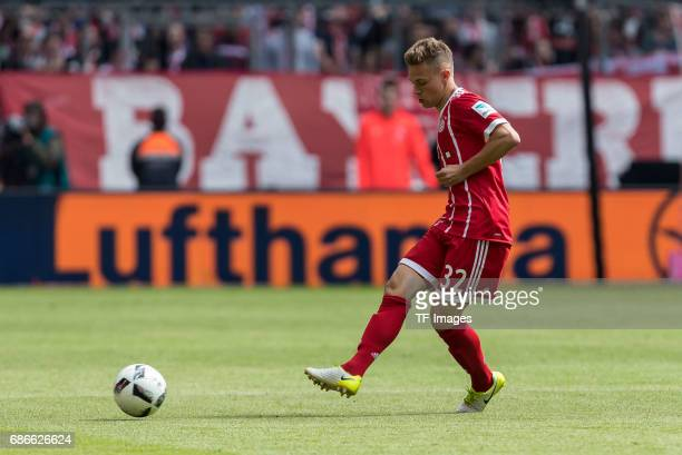Joshua Kimmich of Bayern Muenchen controls the ball during the Bundesliga match between Bayern Muenchen and SC Freiburg at Allianz Arena on May 20...