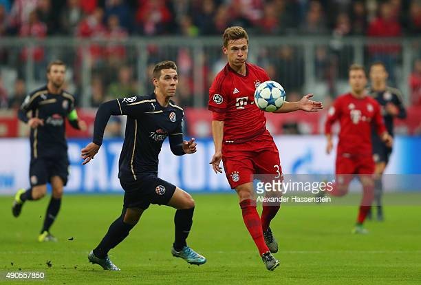 Joshua Kimmich of Bayern Muenchen is closed down by Marko Pjaca of Dinamo Zagreb during the UEFA Champions League Group F match between FC Bayern...