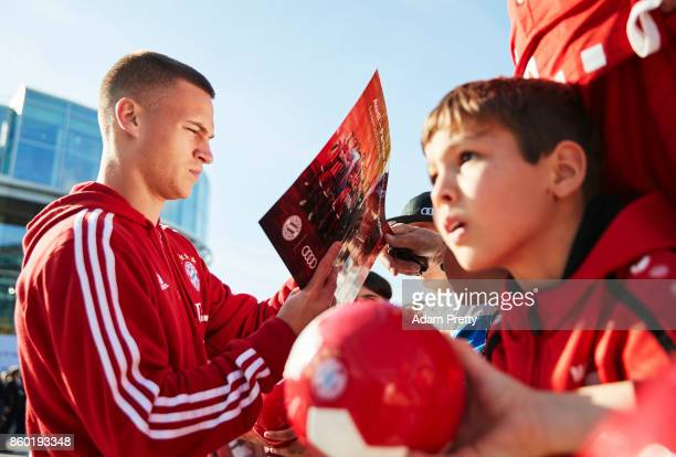 Joshua Kimmich of Bayern Muenchen signs autographs for fans during the FC Bayern Muenchen New Car Handover at the Audi Forum on October 11 2017 in...