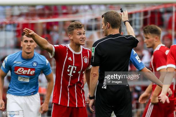 Joshua Kimmich of Bayern Muenchen speak with Referee Benjamin Cortus during the Audi Cup 2017 match between SSC Napoli and FC Bayern Muenchen at...
