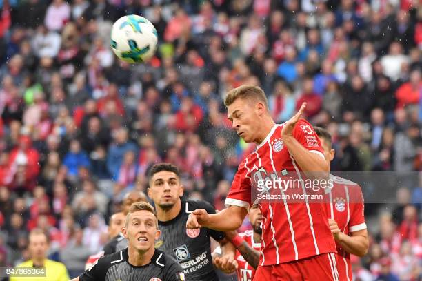 Joshua Kimmich of Bayern Muenchen with a header during the Bundesliga match between FC Bayern Muenchen and 1 FSV Mainz 05 at Allianz Arena on...