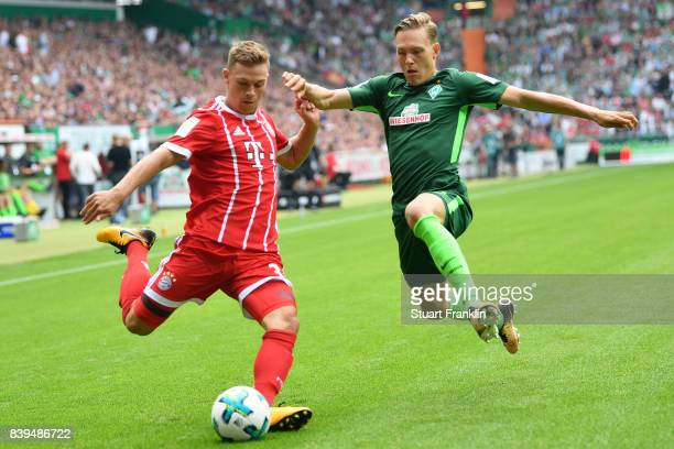 Joshua Kimmich of Bayern Muenchen with Ludwig Augustinsson of Bremen during the Bundesliga match between SV Werder Bremen and FC Bayern Muenchen at...