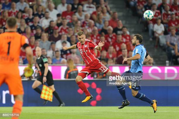 Joshua Kimmich of Bayern Munich and Admir Mehmedi of Bayer 04 Leverkusen vie for the ball during the German First division Bundesliga soccer match...