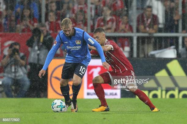 Joshua Kimmich of Bayern Munich and Julian Brandt of Bayer 04 Leverkusen vie for the ball during the German First division Bundesliga soccer match...