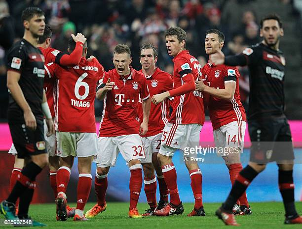 Joshua Kimmich of Bayern Munich celebrates with Thiago after he set up his goal during the Bundesliga match between Bayern Muenchen and Bayer 04...