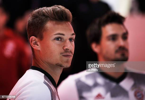Joshua Kimmich of Bayern Munich prepares to warm up before the Bundesliga match between Bayern Muenchen and 1 FSV Mainz 05 at Allianz Arena on April...