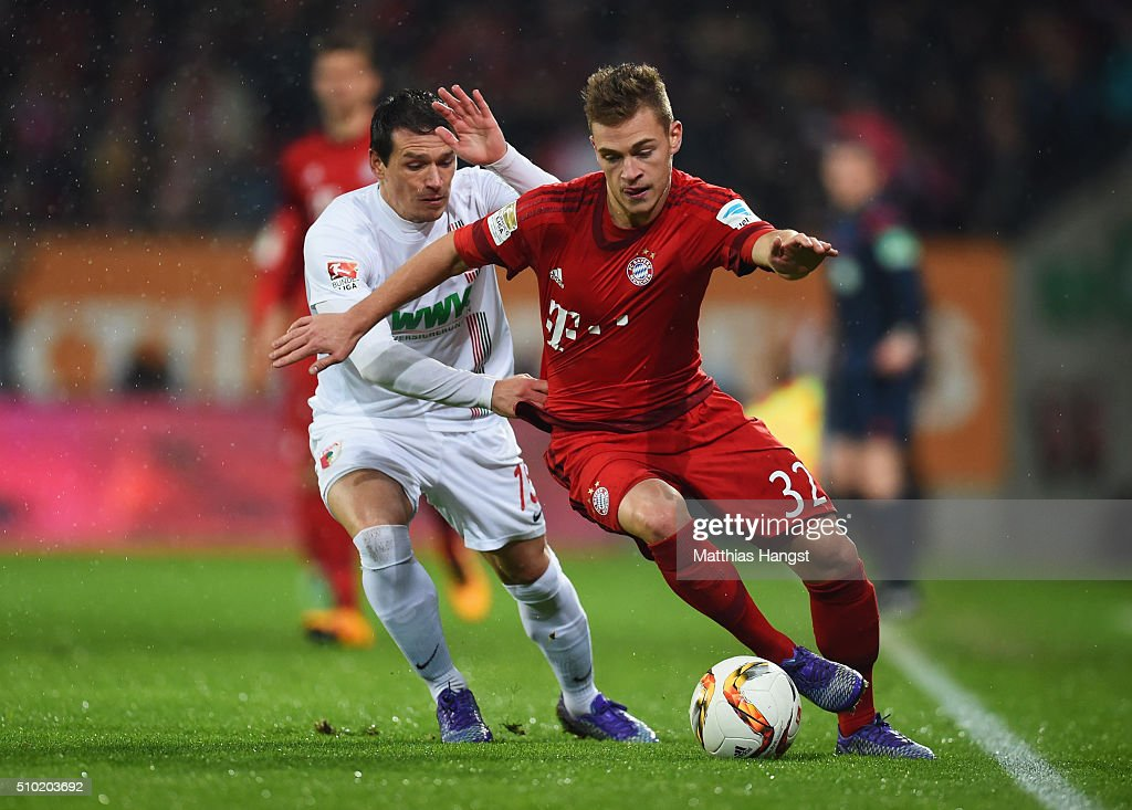 <a gi-track='captionPersonalityLinkClicked' href=/galleries/search?phrase=Joshua+Kimmich&family=editorial&specificpeople=9479434 ng-click='$event.stopPropagation()'>Joshua Kimmich</a> of Bayern Munich takes on <a gi-track='captionPersonalityLinkClicked' href=/galleries/search?phrase=Piotr+Trochowski&family=editorial&specificpeople=635014 ng-click='$event.stopPropagation()'>Piotr Trochowski</a> of Augsburg during the Bundesliga match between FC Augsburg and FC Bayern Muenchen at SGL Arena on February 14, 2016 in Augsburg, Germany.