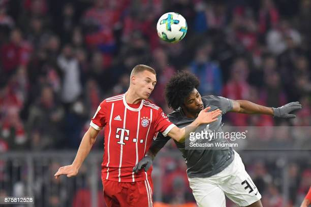 Joshua Kimmich of FC Bayern Muenchen and Francisco da Silva Caiuby of Augsburg jump for a header during the Bundesliga match between FC Bayern...