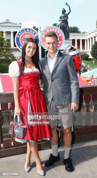 Joshua Kimmich of FC Bayern Muenchen and his girlfriend Lina Meyer attend the Oktoberfest beer festival at Kaefer Wiesenschaenke tent at...