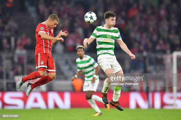 Joshua Kimmich of FC Bayern Muenchen and Kieran Tierney of Celtic FC compete for the ball during the UEFA Champions League group B match between...