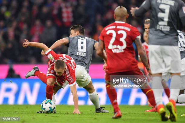 Joshua Kimmich of FC Bayern Muenchen and Rani Khedira of Augsburg compete for the ball during the Bundesliga match between FC Bayern Muenchen and FC...