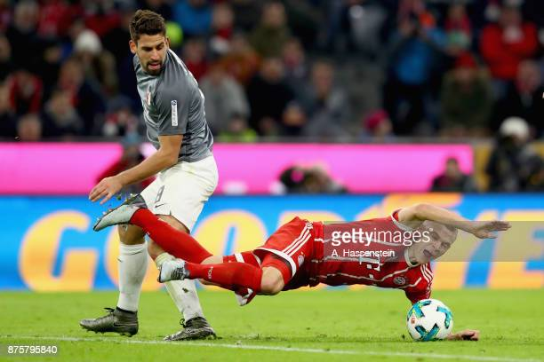Joshua Kimmich of FC Bayern Muenchen battles for the ball with Rani Khedira of FC Augsburg during the Bundesliga match between FC Bayern Muenchen and...