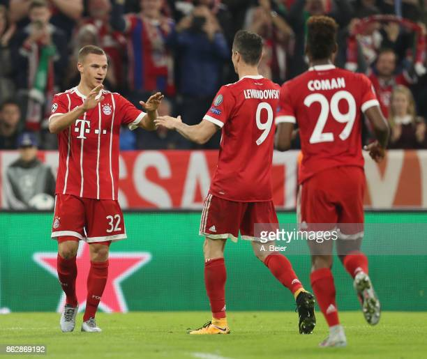Joshua Kimmich of FC Bayern Muenchen celebrates his first goal together with teammates Robert Lewandowski and Kingsley Coman during the UEFA...