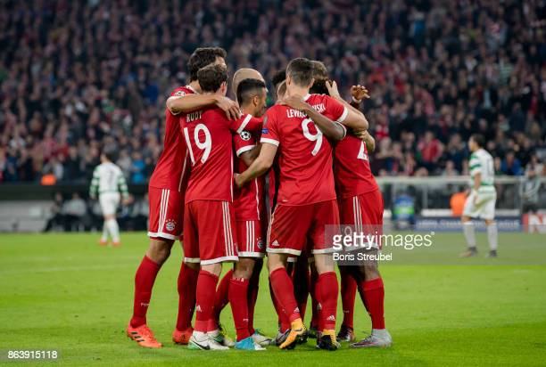 Joshua Kimmich of FC Bayern Muenchen celebrates with team mates after scoring his team's second goal during the UEFA Champions League group B match...