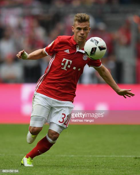 Joshua Kimmich of FC Bayern Muenchen controls the ball during the Bundesliga match between Bayern Muenchen and FC Augsburg at Allianz Arena on April...