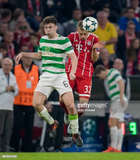 Joshua Kimmich of FC Bayern Muenchen jumps for a header with Kieran Tierney of Celtic FC during the UEFA Champions League group B match between...