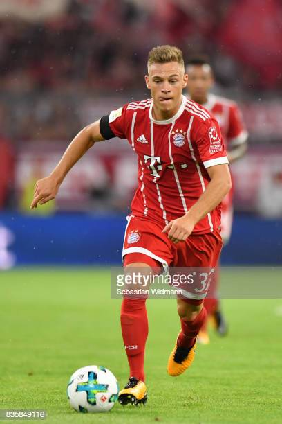 Joshua Kimmich of FC Bayern Muenchen plays the ball during the Bundesliga match between FC Bayern Muenchen and Bayer 04 Leverkusen at Allianz Arena...