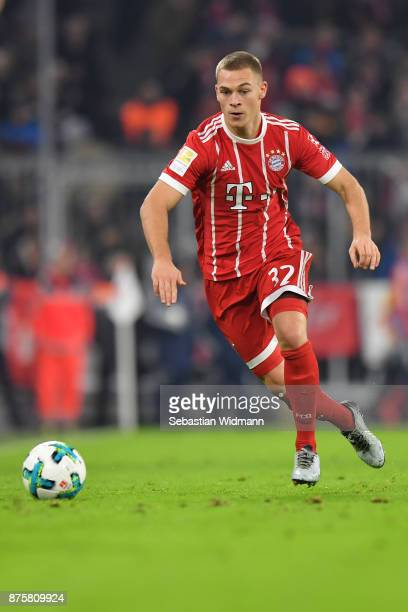Joshua Kimmich of FC Bayern Muenchen plays the ball during the Bundesliga match between FC Bayern Muenchen and FC Augsburg at Allianz Arena on...