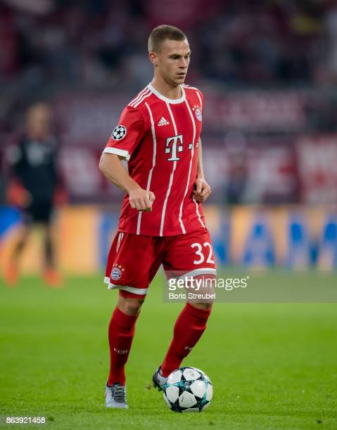 Joshua Kimmich of FC Bayern Muenchen runs with the ball during the UEFA Champions League group B match between Bayern Muenchen and Celtic FC at...