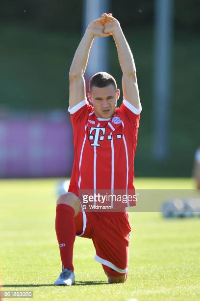 Joshua Kimmich of FC Bayern Muenchen stretches during a training session at Saebener Strasse training ground on October 15 2017 in Munich Germany