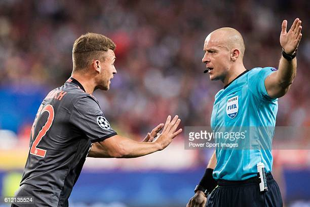 Joshua Kimmich of FC Bayern Munich argues with referee Szymon Marciniak during their 201617 UEFA Champions League match between Atletico Madrid vs FC...