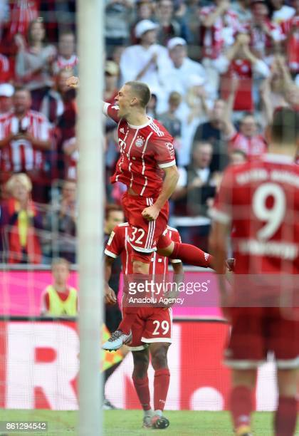 Joshua Kimmich of FC Bayern Munich celebrates after his team's goal during the Bundesliga soccer match between FC Bayern Munich and SC Freiburg at...