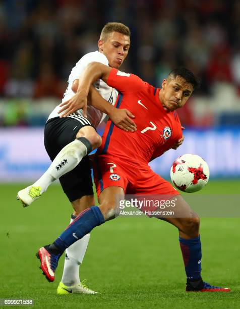 Joshua Kimmich of Germany and Alexis Sanchez of Chile battle for possession during the FIFA Confederations Cup Russia 2017 Group B match between...