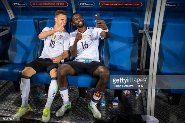 Joshua Kimmich of Germany and Antonio Ruediger celebrate after winning the FIFA Confederations Cup final match between Chile and Germany at Saint...