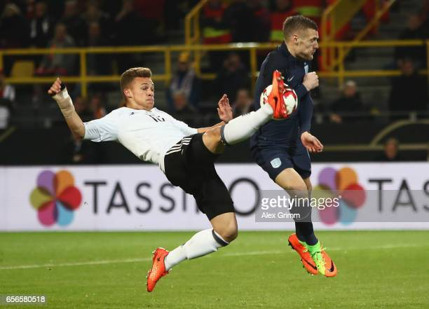Joshua Kimmich of Germany and Jamie Vardy of England clash during the international friendly match between Germany and England at Signal Iduna Park...