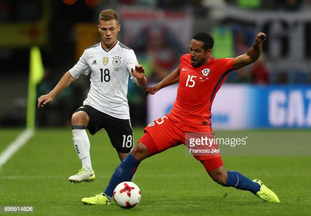 Joshua Kimmich of Germany and Jean Beausejour of Chile battle for possession during the FIFA Confederations Cup Russia 2017 Group B match between...