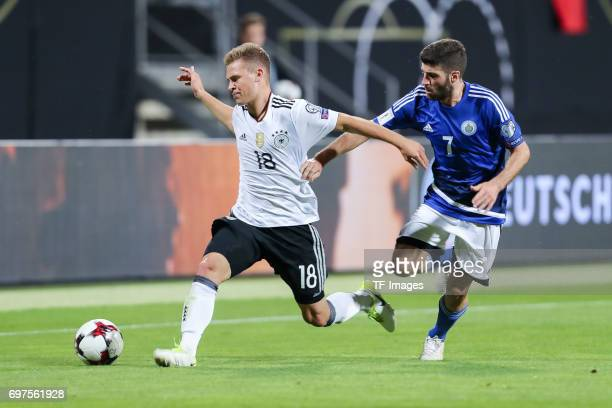 Joshua Kimmich of Germany and Matteo Vitaioli of San Marino battle for the ball during the FIFA 2018 World Cup Qualifier between Germany and San...