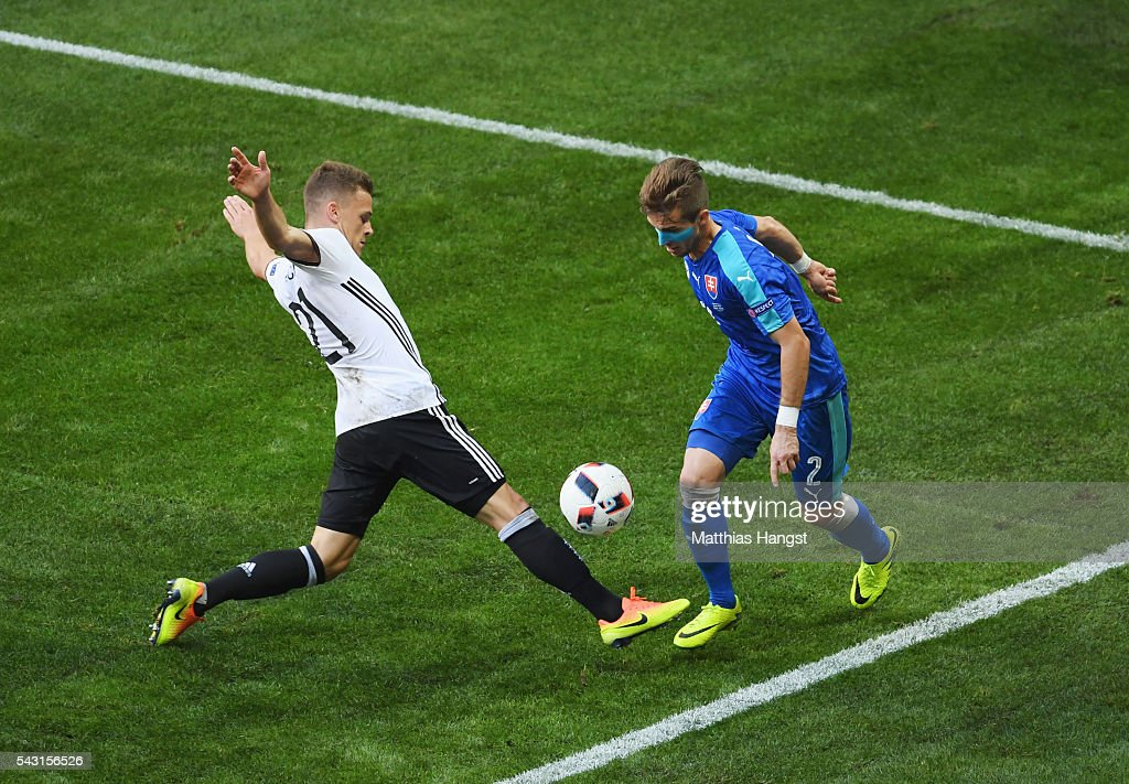 <a gi-track='captionPersonalityLinkClicked' href=/galleries/search?phrase=Joshua+Kimmich&family=editorial&specificpeople=9479434 ng-click='$event.stopPropagation()'>Joshua Kimmich</a> of Germany and <a gi-track='captionPersonalityLinkClicked' href=/galleries/search?phrase=Peter+Pekarik&family=editorial&specificpeople=5577121 ng-click='$event.stopPropagation()'>Peter Pekarik</a> of Slovakia compete for the ball during the UEFA EURO 2016 round of 16 match between Germany and Slovakia at Stade Pierre-Mauroy on June 26, 2016 in Lille, France.