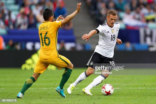 Joshua Kimmich of Germany attempts to take the ball past Aziz Behich of Australia during the FIFA Confederations Cup Russia 2017 Group B match...