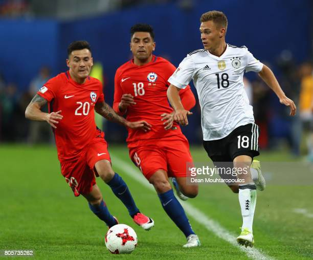 Joshua Kimmich of Germany attemtps to take the ball away from Charles Aranguiz of Chile and Gonzalo Jara of Chile during the FIFA Confederations Cup...