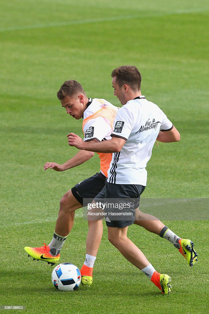 <a gi-track='captionPersonalityLinkClicked' href=/galleries/search?phrase=Joshua+Kimmich&family=editorial&specificpeople=9479434 ng-click='$event.stopPropagation()'>Joshua Kimmich</a> (L) of Germany battles for the ball with his team mate Mario Goetze during a training session at Stadio communale on day 8 of the German national team trainings camp on May 31, 2016 in Ascona, Switzerland.