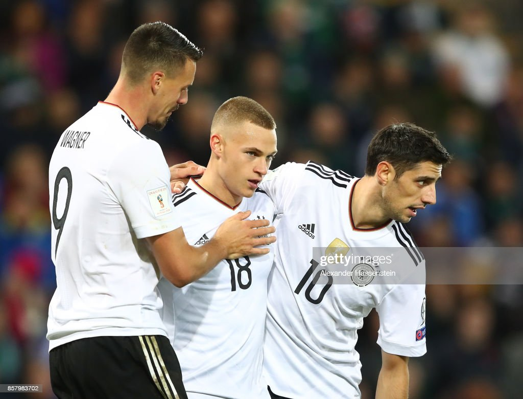 Joshua Kimmich of Germany celebrates scoring the third goal with Lars Stindl and Sandro Wagner during the FIFA 2018 World Cup Qualifier between Northern Ireland and Germany at Windsor Park on October 5, 2017 in Belfast, Northern Ireland.