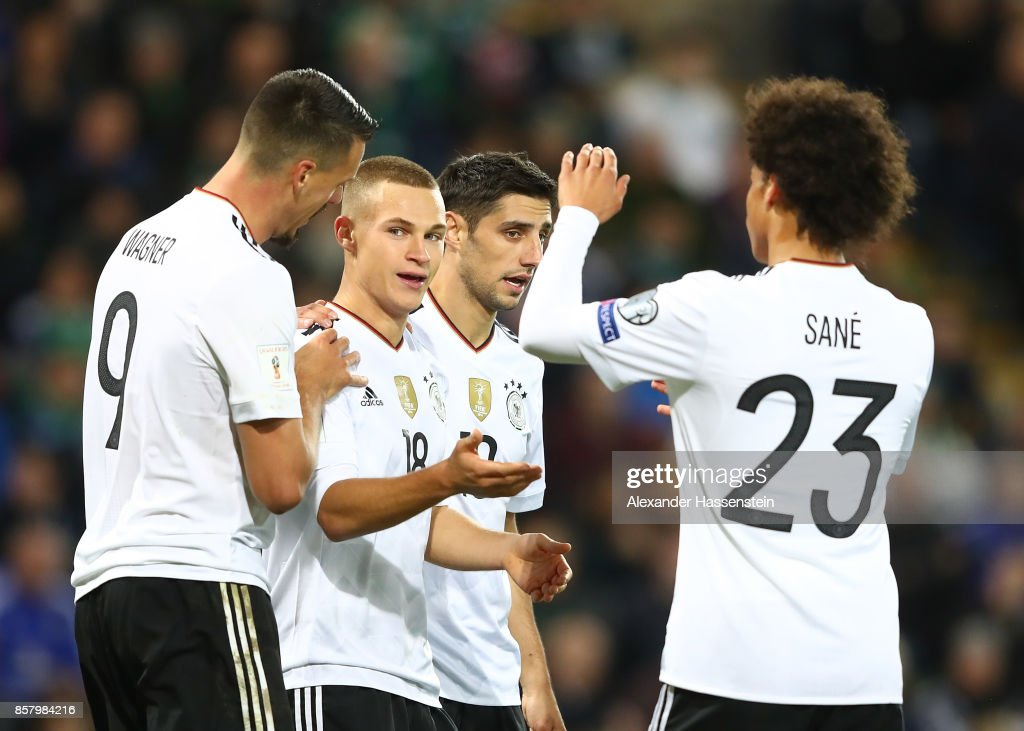Joshua Kimmich of Germany celebrates scoring the third goal with Lars Stindl, Sandro Wagner and Leroy Sane during the FIFA 2018 World Cup Qualifier between Northern Ireland and Germany at Windsor Park on October 5, 2017 in Belfast, Northern Ireland.