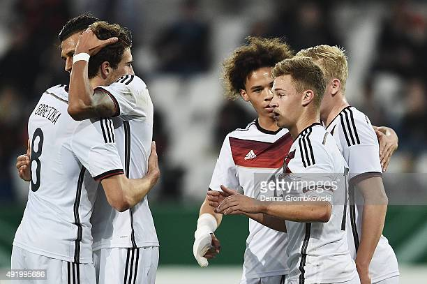 Joshua Kimmich of Germany celebrates with team mates as he scores the third goal during the 2017 UEFA European U21 Championships Qualifier between...
