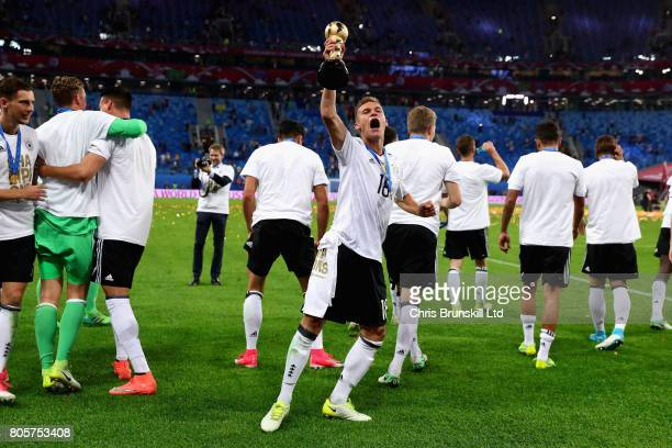 Joshua Kimmich of Germany celebrates with the trophy after the FIFA Confederations Cup Russia 2017 Final match between Chile and Germany at Saint...