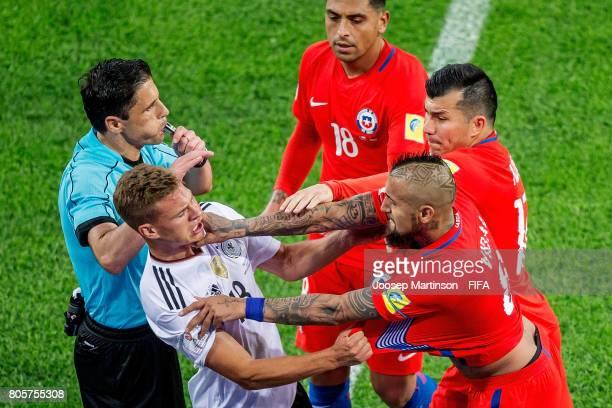 Joshua Kimmich of Germany clashes with Arturo Vidal of Chile during FIFA Confederations Cup Russia final match between Chile and Germany at Saint...